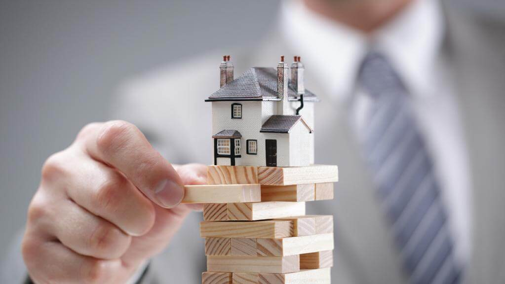 How do Lenders keep an eye on their risk when lending for a real estate development?